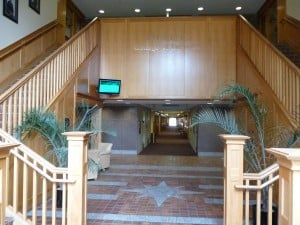 Walking into the building.